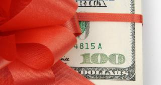 $100 wrapped in red ribbon © Andy Dean Photography/Shutterstock.com