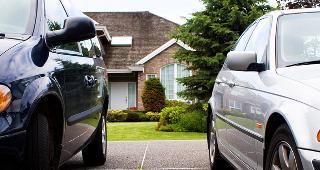 Two cars in driveway © debr22pics/Shutterstock.com
