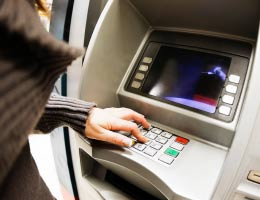 Woman using the ATM