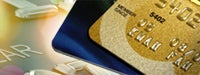 Credit card guide: Two credit cards in front of brighty-lit enlarged credit card