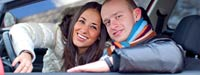 Smiling couple in car