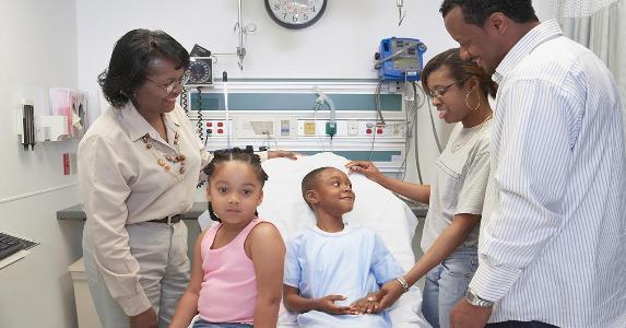 Family visiting young boy in hospital   ERproductions Ltd/Getty Images