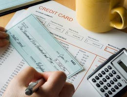 Writing a check to pay credit card bill