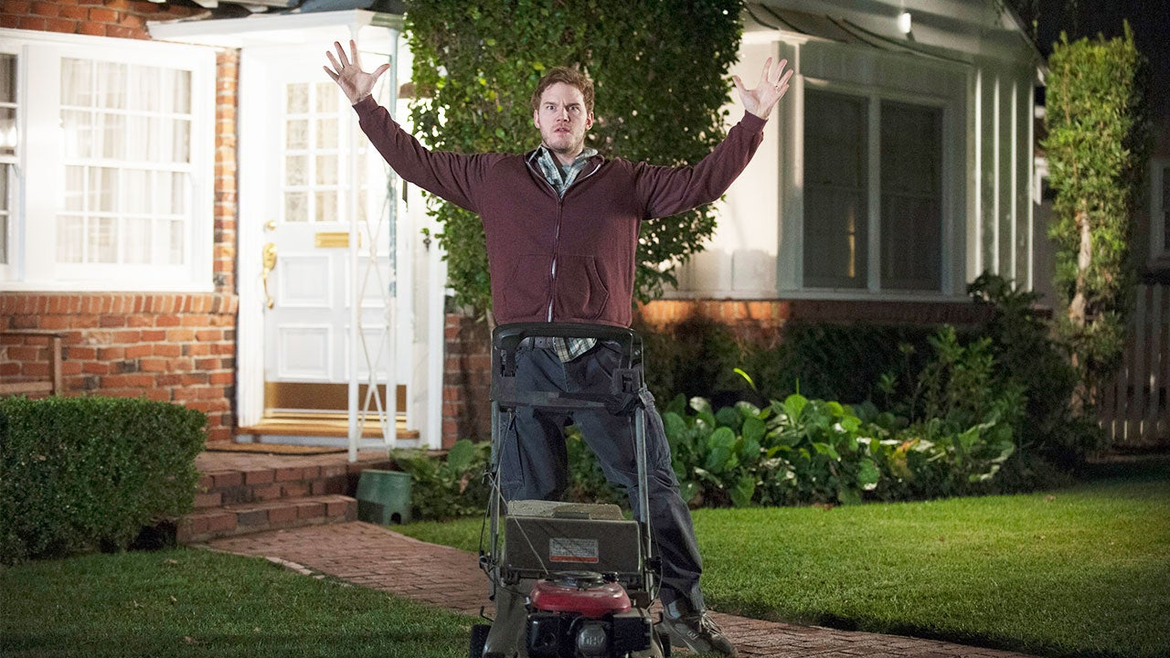 Chris Pratt holding up hands in front yard, surprised | NBC/Getty Images