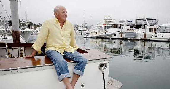 Mature man sitting on marina dock | Blend Images - Peathegee Inc/Getty Images