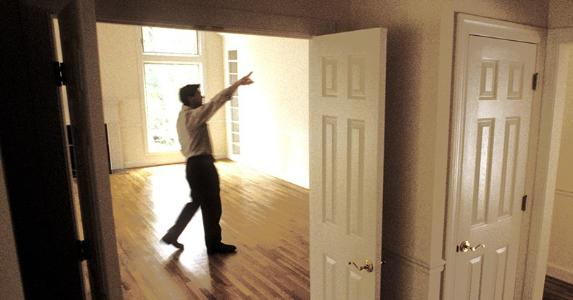 Appraiser walking around the house | kickstand/E+/Getty Images