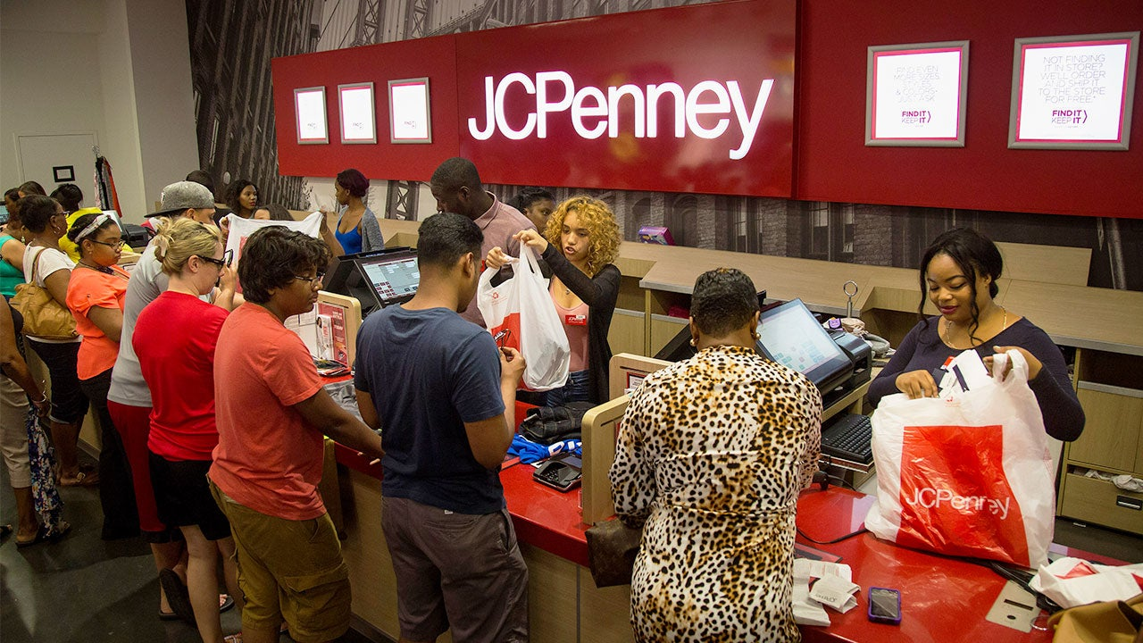 Customers checking out at JCPenney | Bloomberg/Getty Images