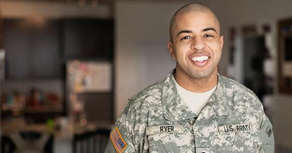 Service member smiling in his living room   Roberto Westbrook/Blend Images/Getty Images
