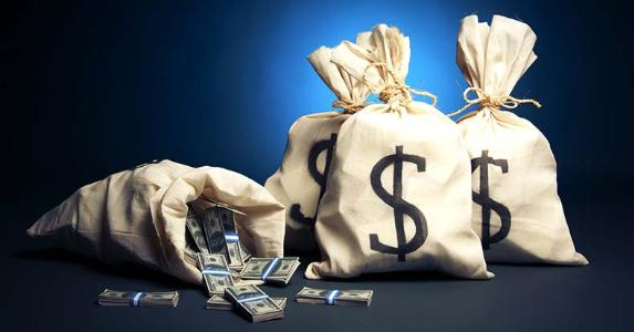 Bags of money in dark blue background © Fer Gregory/Shutterstock.com