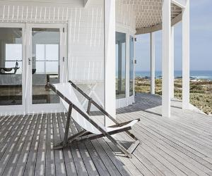 Beach chair on porch | Astronaut Images/Getty Images