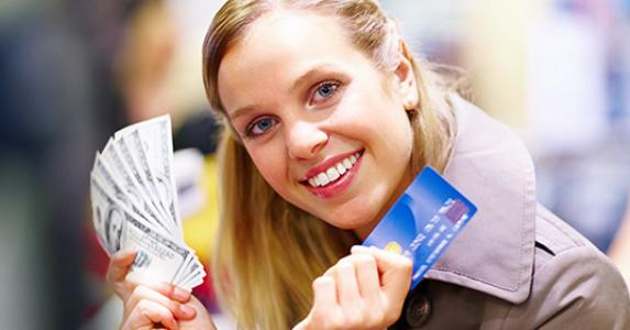 Beautiful lady holding cash and credit card © Yuri Arcurs - Fotolia.com