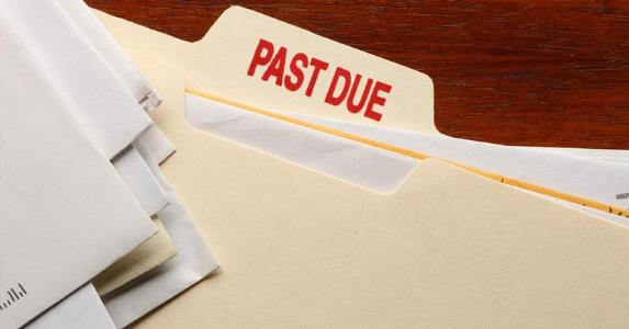 Bills in a 'Past Due' folder © iStock