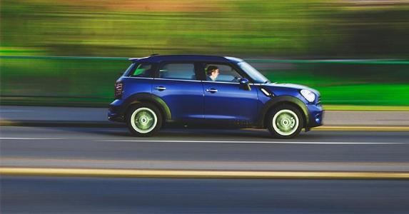 Blue car driving at high speeds | Megapixelstock/Stocksnap