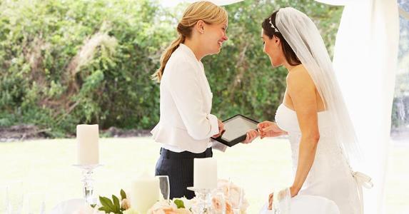 bride talking with wedding planner oliveromgshutterstockcom