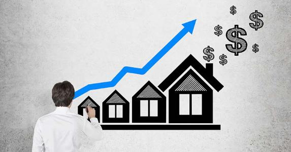 Businessman analyzing a line chart going up depicting increasing home values © iStock