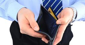 Businessman holding empty wallet © Temych - Fotolia.com
