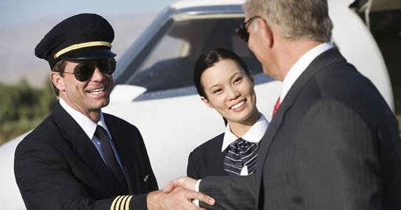 Airplane captain shaking hands with passenger © bikeriderlondon/Shutterstock.com