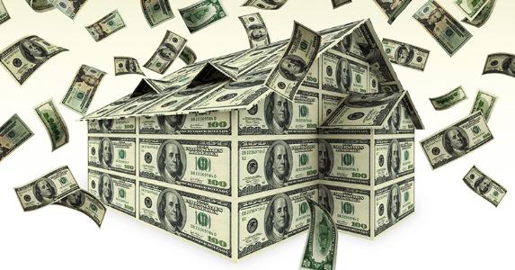 Cash windfall falling on house made of $100 bills © iStock