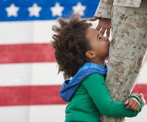 Child hugging military parent's leg   LWA/Dann Tardif/GettyImages