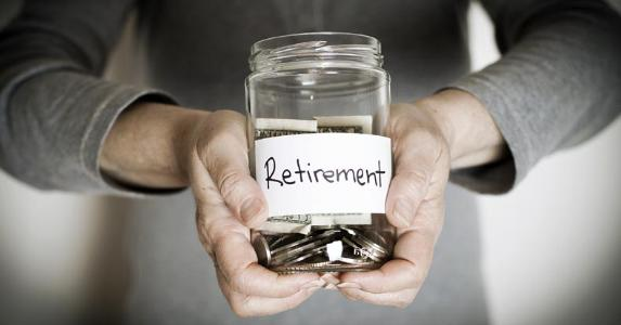 Close-up of a woman holding retirement savings jar © Aysezgicmeli/Shutterstock.com