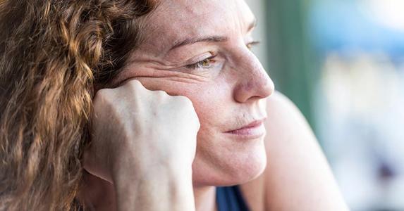 Close up shot of pensive mature woman | Juanmonino/E+/Getty Images