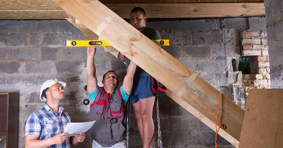 Contractors Building Stairs In Basement © Viacheslav  Nikolaenko/Shutterstock.com