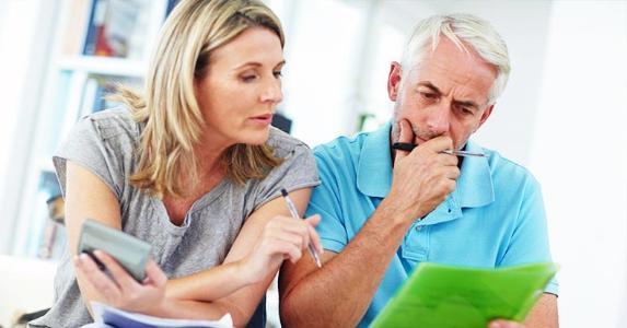 Couple going over finances | iStock.com/gradyreese
