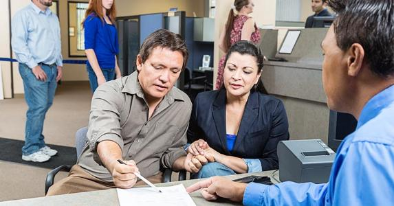 Couple talking to bank rep © Deborah Cheramie/Shutterstock.com