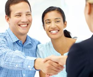 Couple shaking hands with agent  © iStock