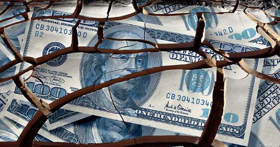 Cracked $100 dollar bill © iStock