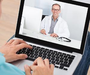 Doctor on laptop display © Andrey_Popov/Shutterstock.com