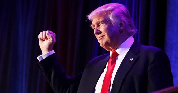 President-elect Donald Trump holding fist up | Joe Raedle/Getty Images