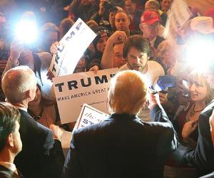 Donald Trump in front of crowd signing autographs | Joe Raedle/Getty Images