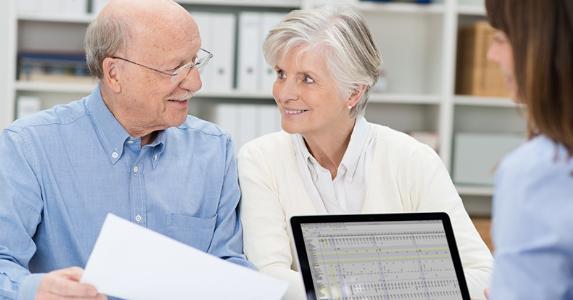 Elderly couple with adviser