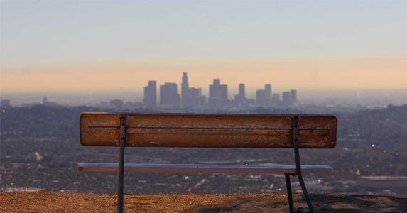 Empty bench overlooking city view | Travis Price/Getty Images