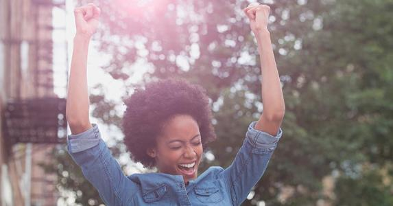 Woman cheering in the street | Jose Luis Pelaez Inc/Shutterstock.com