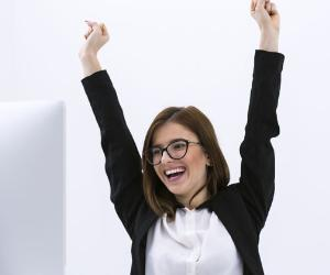 Excited woman with her hands in the air © iStock