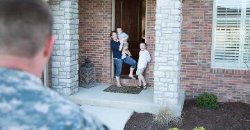Family waiting at front door for returning serviceman | Veterans United