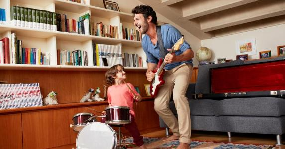 Father and son making music together | Morsa Images/Digital Vision/Getty Images