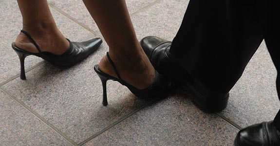 Male foot stepping over female foot   The India Today Group/Getty Images