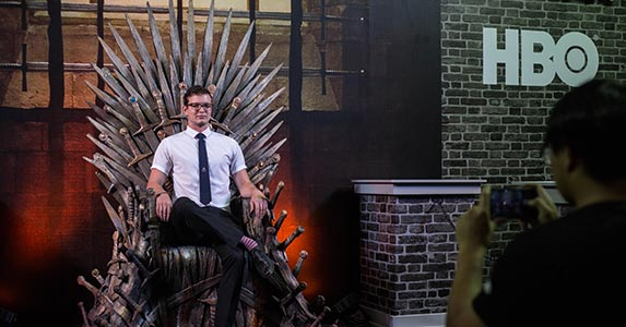 Man sitting on Iron Throne from 'Game of Thrones' | Anadolu Agency/Getty Images
