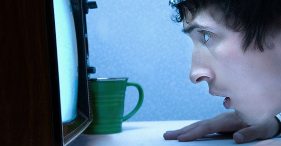Staring at a TV | Trevor Hunt/E+/Getty Images