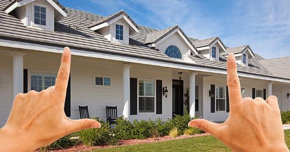 Female hands framing dream house, goal © Andy Dean - Fotolia.com