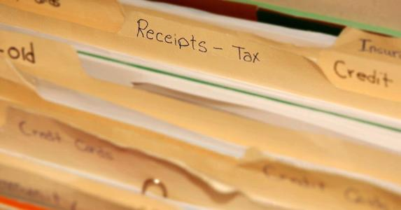 Folder of tax receipts © iStock