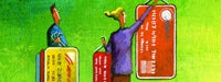 A man and woman cartoon hanging up colorful credit cards on a green wall
