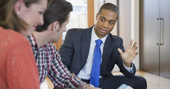 Financial adviser talking to clients | Hero Images/Getty Images