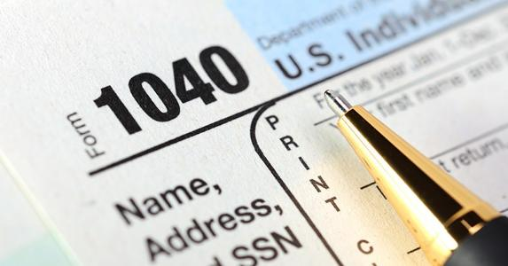 Form 1040, close-up on name, address and Social Security number © Garry L./Shutterstock.com