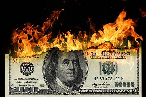 Burning dollars: © bioraven/Shutterstock.com