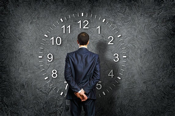 Businessman looking at a clock: © Sergey Nivens/Shutterstock.com