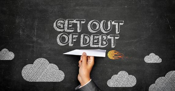 'Get out of debt' written on blackboard | iStock.com/NorthernStock